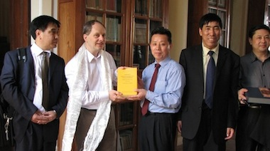 Deputy director Liu Yinghua presenting CTRC publications to Dominic Goodall