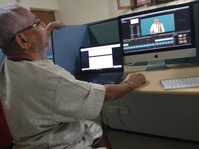 S.L.P. Anjaneya Sarma helping to edit the videos of his classes
