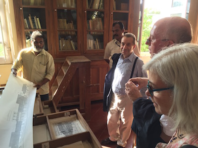 Babu (N. Ramaswamy) showing maps and drawings to Mr. Bruno Racine.