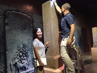 Kunthea Chhom and Dominic Goodall studying an inscription