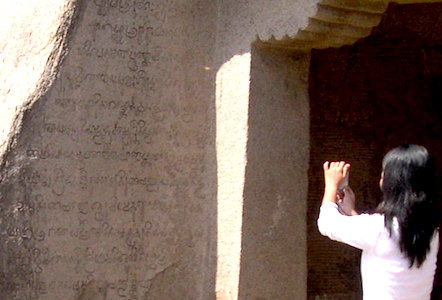 Kunthea Chhom, straight out of Chennai airport, examines the digraphic inscription of the Atiraṇacaṇḍeśvara temple in Mahabalipuram, at the beginning of her first stay in Pondicherry in 2004